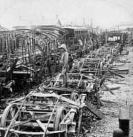 0116707 © Granger - Historical Picture ArchiveCHINA: BOXER REBELLION.   Railroad cars destroyed by fire at the station during the battle at Tientsin, China. Stereograph, c1901.