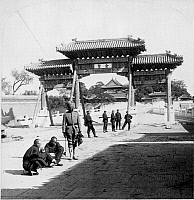 0116773 © Granger - Historical Picture ArchiveCHINA: PEKING, c1901.   A view looking east over Marble Bridge toward the Forbidden City in Peking, China, with Indian soldiers and two Chinese men in front of a gate. Stereograph, c1901.