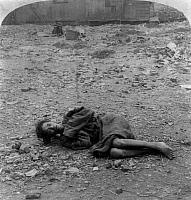 0118177 © Granger - Historical Picture ArchiveCHINA: POVERTY, c1900.   A woman lying on the ground in the 'dying field' where the poor are allowed to come and die, Canton, China. Stereograph, c1900.