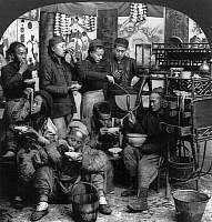 0118178 © Granger - Historical Picture ArchiveCHINA: CANTON, c1919.   A group of Chinese men eating at a street kitchen or 'movable chow shop,' Canton, China. Stereograph, c1919.
