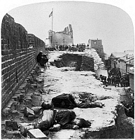 0121161 © Granger - Historical Picture ArchiveCHINA: BOXER REBELLION.   The remains of Chinese Boxer rebels, killed during fighting with foreign expeditionary forces at Tientsin, China, lying behind fortifications at the city's south gate, 14 July 1900. Stereograph.