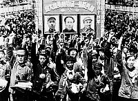 0121360 © Granger - Historical Picture ArchiveCHINA: PEKING, 1949.   Crowds in Peking, China, welcome victorious Communist troops following the withdrawal of Nationalist forces from the city, 31 January 1949. Portraits of Chinese Communist leaders are shown at top, the center of which is of Mao Tse-tung.