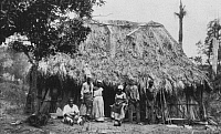 0103697 © Granger - Historical Picture ArchiveCUBA: PLANTATION WORKERS.   A group of elderly black workers in front of a palm frond house on a sugar plantation in Cuba. Photographed by José Gomez de la Carrera in 1886, the year slavery in Cuba was abolished.