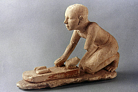0024761 © Granger - Historical Picture ArchiveEGYPTIAN LIMESTONE FIGURE.   Figure of a baker kneading dough, c2100 B.C.