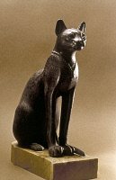0024774 © Granger - Historical Picture ArchiveEGYPTIAN BRONZE STATUETTE   Statuette of a cat, possibly of the goddess Bastet. Late Dynastic Period.