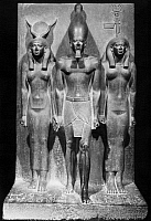 0116127 © Granger - Historical Picture ArchiveEGYPT: HATHOR AND KING.   King Menkaure between the goddess Hathor, left, and a local deity. Stone sculpture, 4th Dynasty, c2500 B.C.