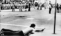0094816 © Granger - Historical Picture ArchiveEL SALVADOR: PROTEST, 1979.   A Salvadoran leftist protestor aims a pistol when word had spread of approaching police during an anti-government protest, 11 September 1979.