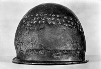 0072583 © Granger - Historical Picture ArchiveETRUSCAN ART, 474 B.C.   Etruscan bronze helmet dedicated at Olympia by Hieron of Syracuse after his victory over the Etruscans, 474 B.C. 'Hieron, son of Deinomenes, and the Syracusans to Zeus; Etruscan, from Cumae.'