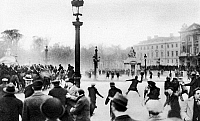 0079034 © Granger - Historical Picture ArchiveFRANCE: PARIS RIOTS, 1934.   A rioter hurling a missle from behind mounted police in the Place de la Concorde in Paris during the Stavisky riots of 6-8 February 1934.