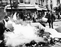 0117848 © Granger - Historical Picture ArchivePARIS STUDENT REVOLT, 1968.   Students feeding the fire set to a barricade of garbage at Boulevard St. Germain on the Left Bank in Paris, France, 23 May 1968.