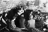 0259664 © Granger - Historical Picture ArchiveFRANCE: GUITAR CONCERT.   Students listening to a guitar player at a cafe in Paris, France. Photograph, c1960.