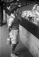 0432801 © Granger - Historical Picture ArchiveTRAVEL TO FRANCE.   France - Little boy's shopping at the Bouquinistes, the books flea market in Paris.  Image date circa 1950. Photo Erich Andres. Full credit: United Archives / Granger, NYC -- All rights reserved.