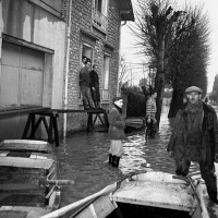 0525688 © Granger - Historical Picture ArchiveFRANCE: FLOODING, 1955.   Residents in the flood waters of the Seine in Fontainebleau, France. Photograph by Gerald Bloncourt, January 1955. Full credit: Gerald Bloncourt - Rue des Archives / Granger, NYC.