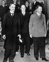 0006119 © Granger - Historical Picture ArchiveHITLER & CHAMBERLAIN, 1938.   Prime Minister Neville Chamberlain of Great Britain (left) and German Chancellor Adolf Hitler leaving the Hotel Dreesen at Godesberg, Germany, after their midnight meeting of 23-24 September 1938.