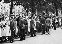 0006879 © Granger - Historical Picture ArchiveGERMANY: 1934 BLOOD PURGE.   Crowds, awaiting a reassuring glimpse of German Chancellor Adolf Hitler, outside the Chancellery in the Wilhelmstrasse, Berlin, Germany, on 1 July 1934, following the 'blood purge' of the night before.