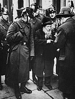 0101949 © Granger - Historical Picture ArchiveNAZI ANTI-SEMITISM, 1933.   Police questioning an elderly man in the foreign Jews' quarter of Berlin, April 1933.