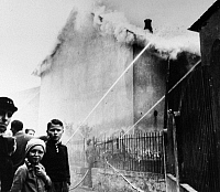 0115764 © Granger - Historical Picture ArchiveKRISTALLNACHT, 1938.   Residents of Ober-Ramstadt, Germany, watch as local firefighters work to prevent fires from spreading from the synagogue to nearby homes, while permitting the synagogue to continue burning in the aftermath of the Kristallnacht pogrom, 9-10 November 1938.
