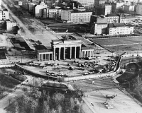 0186207 © Granger - Historical Picture ArchiveBRANDENBURG GATE, 1961.   Aerial view of the Brandenburg Gate following construction of the Berlin Wall (towards the foreground) along the boundary between East and West Berlin. Photograph, probably late 1961.