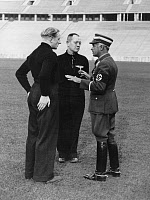 0408742 © Granger - Historical Picture ArchiveGERMANY: SOCCER, 1936.   Reich Sports Leader Hans von Tschammer und Osten interviewing German national team coach Otto Nerz and player Fritz Szepan at the Olympic Stadium in Berlin. Photograph, 1936.