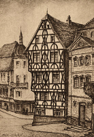0433610 © Granger - Historical Picture ArchiveGERMANY: ASCHAFFENBURG.   A half timbered house in Aschaffenburg, Germany. Illustrated, c1930.