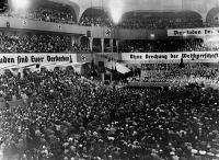 0622907 © Granger - Historical Picture ArchiveBERLIN: NAZI RALLY, 1935.   The Sportpalast arena in Berlin, decorated with anti-Semitic slogans and filled with a capacity crowd for a speech by Nazi propagandist Julius Streicher. Photograph, 1935.