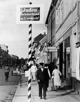 0622909 © Granger - Historical Picture ArchiveNAZI GERMANY, 1935.   A sidewalk sign bearing the message 'Juden sind in dieser Ortschaft nicht erwuenscht!' ('Jews not wanted in this town!'), Schwedt, Germany. Photograph, 1935.