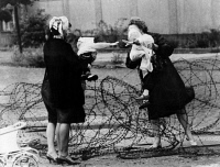 0623365 © Granger - Historical Picture ArchiveBERLIN WALL, 1961.   Two mothers with children facing each other across barbed wire placed in advance of the construction of the Berlin Wall. Photograph, 13 August 1961. Full Credit: ullstein bild - Hilde / Granger, NYC. All Rights Reserved.
