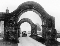 0622866 © Granger - Historical Picture ArchiveSAWLEY ABBEY, c1940.   An automobile driving beneath archways at the ruins of Sawley Abbey in Lancashire, England. Photograph, early 20th century.