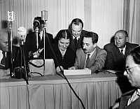0115397 © Granger - Historical Picture ArchiveISRAELI INDEPENDENCE, 1948.   The signing of the Israeli Declaration of Independence at the Tel Aviv Museum, 14 May 1948. Seated in front are Golda Meir and Moshe Sharett.