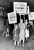 0621843 © Granger - Historical Picture ArchivePARTITION OF IRELAND, 1949.   Protesters decrying the ongoing partition of Ireland await the arrival of British politicians Ernest Bevin and Stafford Cripps at the Hudson River pier. Photograph, 1949.