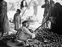 0130359 © Granger - Historical Picture ArchiveIRAQ: FRUIT VENDOR, c1932.   A pomegranate vendor at a market in Mosul, Iraq. Photograph, c1932.