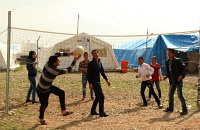 0623468 © Granger - Historical Picture ArchiveIRAQ: REFUGEE CAMP, 2014.   Young men and women play volleyball in a United Nations refugee camp for Syrian refugees in northern Iraq. Photograph, 27 February 2014. Full Credit: ullstein bild - snapshot-photography / B.Shamlo / Granger. All Rights Reserved.