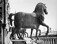 0124642 © Granger - Historical Picture ArchiveVENICE: SAINT MARK'S.   Ancient Roman bronze horse statues at the front of Saint Mark's Basilica, overlooking Saint Mark's Square in Venice, Italy. Photograph, early 20th century.