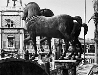 0124643 © Granger - Historical Picture ArchiveVENICE: SAINT MARK'S.   Ancient Roman bronze horse statues at the front of Saint Mark's Basilica, overlooking Saint Mark's Square in Venice, Italy. Photograph, early 20th century.