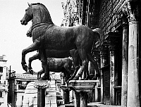 0124644 © Granger - Historical Picture ArchiveVENICE: SAINT MARK'S.   Ancient Roman bronze horse statues at the front of Saint Mark's Basilica, overlooking Saint Mark's Square in Venice, Italy. Photograph, early 20th century.