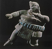 0103505 © Granger - Historical Picture ArchiveMAYAN ATHLETE, 700-900 A.D.   Ceramic figure of a Mayan ball player wearing a thick protective belt, gauntlets and leggings. From Jaina, Campeche, Mexico, 700-900 A.D. Height: 12.8 cm.