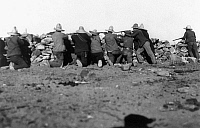 0123432 © Granger - Historical Picture ArchiveMEXICAN REVOLUTION, 1911.   Mexican revolutionary troops armed with rifles take position behind a stone wall during the Mexican Revolution, February 1911.