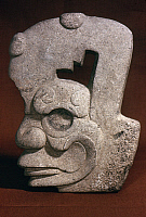 0168428 © Granger - Historical Picture ArchiveMEXICO: HACHA.   Carved stone hacha in the form of a human head, from Veracruz, Mexico, c550-1150 A.D.
