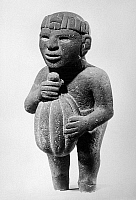 0168443 © Granger - Historical Picture ArchiveMEXICO: AZTEC FIGURE.   Aztec stone standing figure of a man carrying a cacao pod, from Amatlan, Veracruz, Mexico, 1440-1521. Height: 14 1/4 inches.