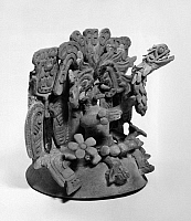 0168504 © Granger - Historical Picture ArchiveMEXICO: TEOTIHUACAN CENSOR.   Modeled clay censor representing the god, Quetzalcoatl seated on a throne, holding a symbolic feathered serpent. By the Teotihuacan culture, Mexico, 500-650 A.D.