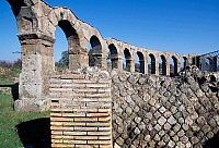 0410276 © Granger - Historical Picture ArchiveARCHAEOLOGY.    Colonnade with arches, ruins of the Roman theatre, Ferento, Lazio, Italy. Roman civilisation, 1st century. Full credit: De Agostini / S. Vannini / Granger, NYC -- All Rights Reserved.