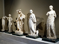 0410313 © Granger - Historical Picture ArchiveARCHAEOLOGY.    Marble statues of Apollo Citaredo and four muses, artefacts uncovered from the frigidarium of the Baths of Faustina, Miletus, Turkey. Roman Civilisation, 2nd century. Full credit: De Agostini Picture Library / Granger, NYC -- All Rights Reserved.