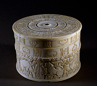 0411386 © Granger - Historical Picture ArchiveARCHAEOLOGY.    Cylindrical box with lid, decorated with reliefs depicting animals and floral motifs, ivory. Fatimid period, 12th century. Full credit: De Agostini Picture Library / Granger, NYC -- All rights reserved.