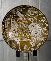 0411387 © Granger - Historical Picture ArchiveARCHAEOLOGY.    Plate decorated with a hunter on horseback with a hawk, ceramics. Fatimid period, 11th century. Full credit: De Agostini Picture Library / Granger, NYC -- All right