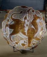 0411388 © Granger - Historical Picture ArchiveARCHAEOLOGY.    Plate decorated with a griffin, lusterware. Fatimid period, 11th century. Full credit: De Agostini Picture Library / Granger, NYC -- All rights reserved.