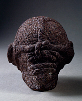 0411597 © Granger - Historical Picture ArchiveARCHAEOLOGY.    Stone head of the god Xipe Totec, The Flayed, rear view, Mexico. Aztec civilisation, 14th-16th century. Full credit: De Agostini / G. Dagli Orti / Granger, NYC -- All Rights Reserved.