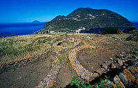 0411793 © Granger - Historical Picture ArchiveARCHAEOLOGY.    Remains of oval huts, prehistoric village of Capo Graziano, Filicudi Island, Aeolian Islands, Sicily, Italy. Full credit: De Agostini / F. Barbagallo / Granger, NYC -- All Rights Reserved.