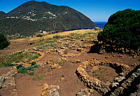 0411795 © Granger - Historical Picture ArchiveARCHAEOLOGY.    Remains of oval huts, prehistoric village of Capo Graziano, Filicudi Island, Aeolian Islands, Sicily, Italy. Full credit: De Agostini / F. Barbagallo / Granger, NYC -- All Rights Reserved.