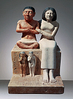 0412587 © Granger - Historical Picture ArchiveARCHAEOLOGY.    The dwarf Seneb Sentiotes with his wife and two children, sculptural group, painted limestone from Giza. Egyptian Civilisation, Old Kingdom, Dynasty IV-V. Full credit: De Agostini / G. Dagli Orti / Granger, NYC -- All rights