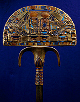 0412850 © Granger - Historical Picture ArchiveARCHAEOLOGY.    Ceremonial flabellum, wood covered with gold leaf and inlaid with coloured glass, from the Tomb of Tutankhamun. Egyptian Civilisation, New Kingdom, Dynasty XVIII. Full credit: De Agostini / G. Dagli Orti / Granger, NYC -- All Rights Reserved.